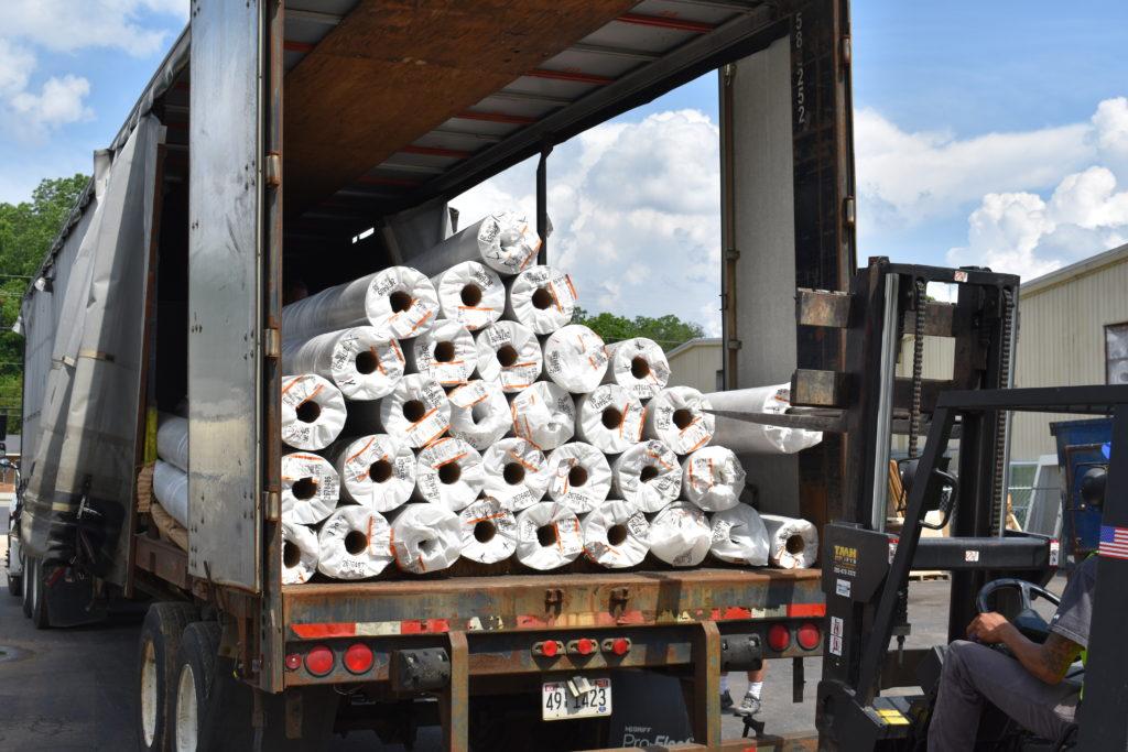 Unloading 38 Rolls of Linolieum