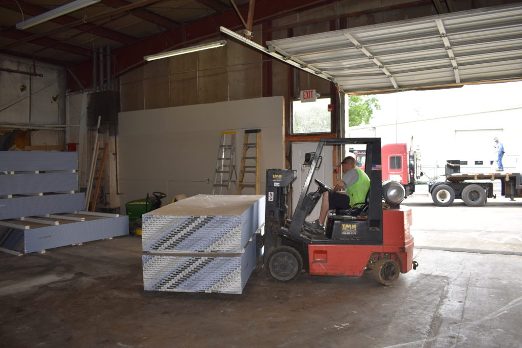 Stacking Drywall in Habitat of Madison County's Facility